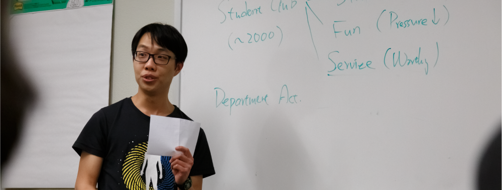 student presenting at a whiteboard